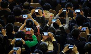 People On Phones at Conference
