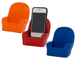 A company called bluetach sells little stress balls in the shape of a chair.This is a picture of three of them- one is orange, one is red, one is blue. The phone sits on the red one.