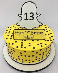 This is a yellow birthday cake with the logo of Snapchat on the top, where the candles would normally be. The images was posted on Pinterest.